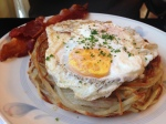 Stuffed Rosti Potato With Sun-Dried Tomatoes, Basil and Mozzarella, Topped With Two Eggs, Served With A Side of Salsa